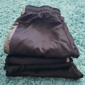 Lot of 4 pairs of black athletic pants